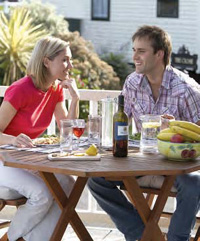 A couple enjoying a meal on their new Garden Decking