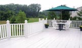 Beautiful white vinyl uPVC Decking with matching railings and decking boards